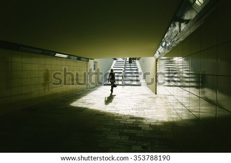 A fancy woman walking in the new underpass in Monza, Via Bergamo, Italy