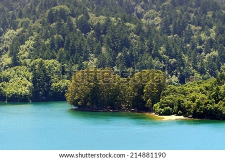 A Fantastic View Of A Mountain Lake With Amazing Blue And Green Colors. Photo taken at Crystal Springs Reservoir, which supplies San Francisco, California with fresh water and is in a nature preserve. - stock photo