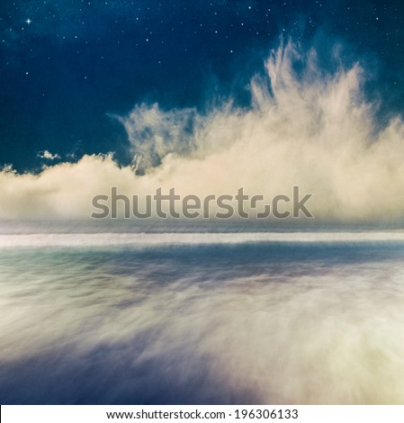 A fantasy seascape at night with swirling fog on the horizon.  Image has a distinct paper grain and texture at 100 percent.