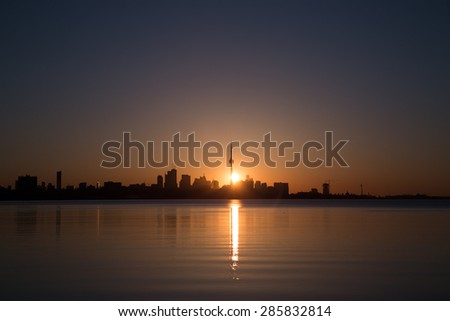 A far view of the Toronto Skyline at Sunrise showing skyscrapers and buildings downtown - stock photo