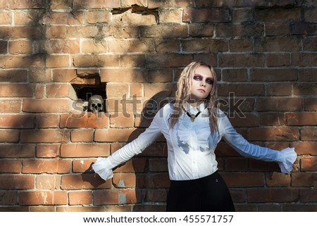 A fashion gothic style portrait of a beautiful blonde girl