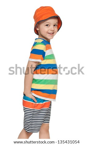 A fashion little boy is walking; on the white background