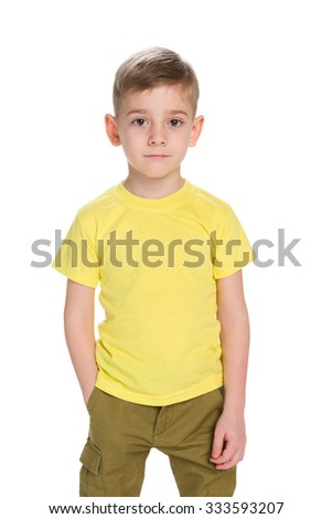 A fashion little boy stands against the white