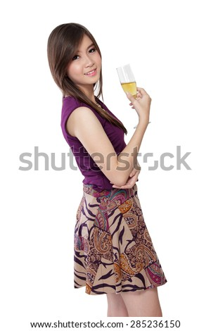 A fashionable Asian girl in purple dress pose with a glass of champagne, isolated on white background - stock photo