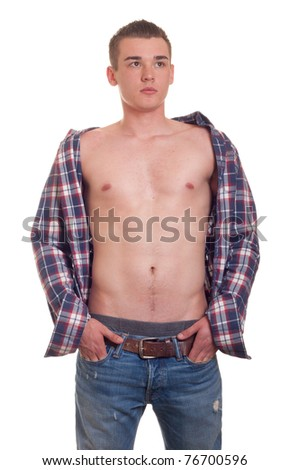A fashionable photograph of a hot young man looking in the distance. - stock photo