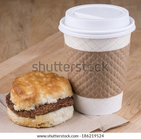 A fast breakfast of biscuits  sausage and coffee - stock photo