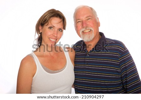 A Father and daughter pose for a photo