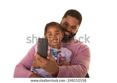 A father and his daughter using technology - stock photo