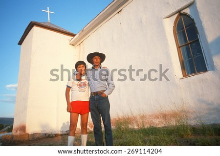 A father and son at a church, NM - stock photo