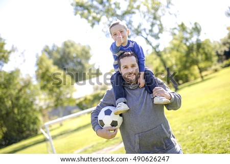 A Father and Son Playing Ball in The Park