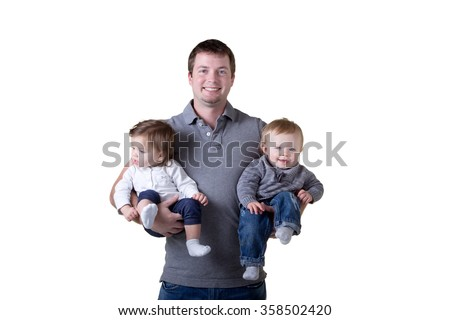 A father holding his boy and girl twins - stock photo