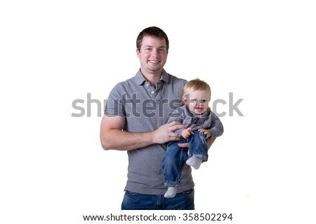A father holding his son - stock photo