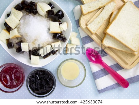 A favorite dessert in summer. Homemade Shaved ice with red soda,milk, bread and black jelly.