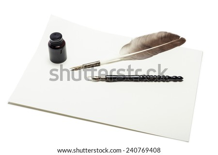 A feather quill pen, fountain pen, letter, envelope, ink isolated white at the studio. - stock photo