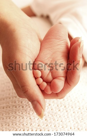 a feet cute newborn little baby