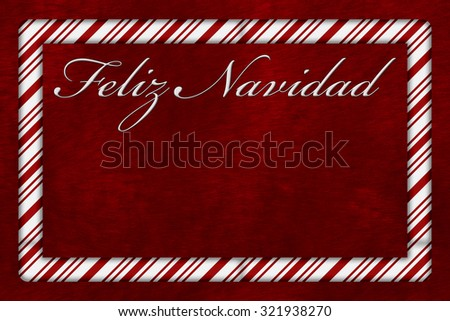 A Feliz Navidad - Merry Christmas card, A Candy Cane border with words Feliz Navidad over red plush background with copy-space - stock photo