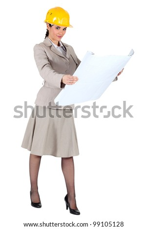 A female architect checking her plans. - stock photo