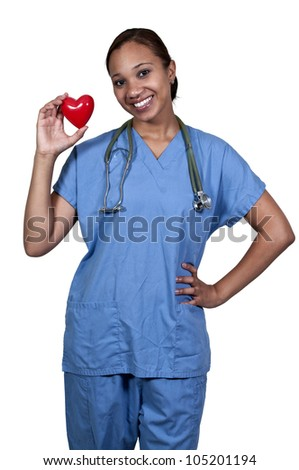 A female cardiologist woman doctor holding a red heart - stock photo