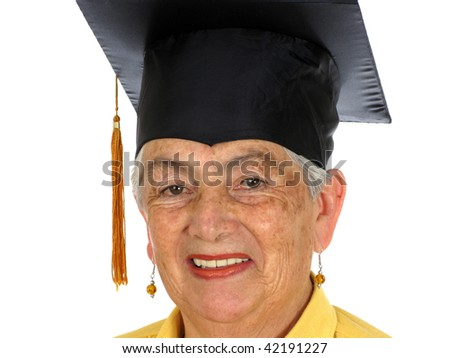 A female caucasian in yellow graduation over white background - stock photo