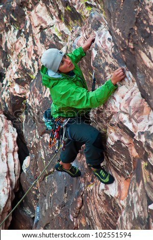 A Female Climber on a Wall in Red Rocks, Nevada - stock photo