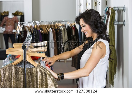 A female consumer shopping in an indoor store - stock photo