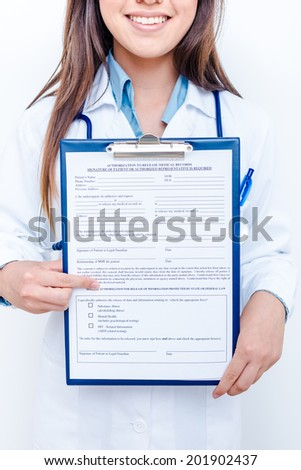 A female doctor with a folder, standing isolated on white background