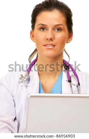 A female doctor working on the laptop