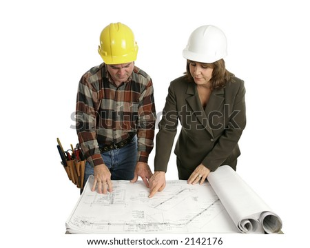 A female engineer and a building contractor reviewing blueprints.  Isolated on white. - stock photo