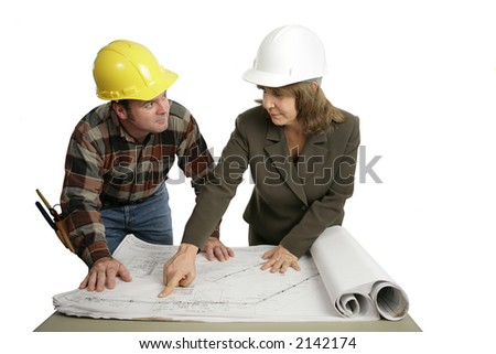 A female engineer going over blueprints with a building contractor.  Isolated on white. - stock photo