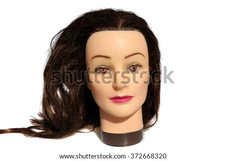A female Hair Dressers Mannequin Head.  Isolated on white with room for your text. - stock photo