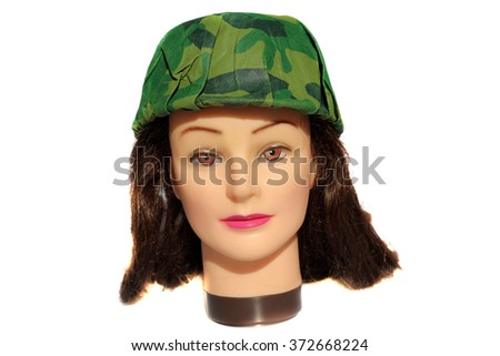 A female Hair Dressers Mannequin Head wears a Army Hat.  Isolated on white with room for your text. - stock photo