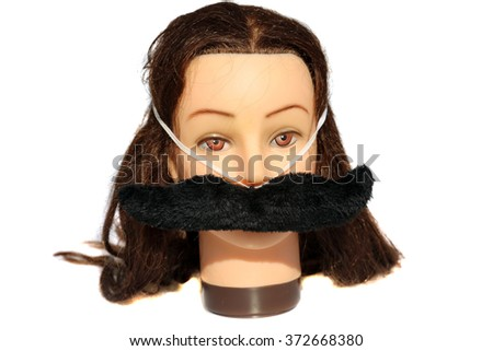A female Hair Dressers Mannequin Head wears a Black Fuzzy Moustache .  Isolated on white with room for your text. - stock photo