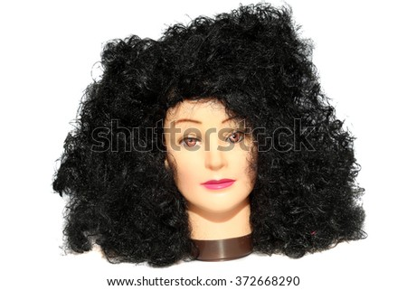 A female Hair Dressers Mannequin Head wears a Black Wild Fuzzy Wig.  Isolated on white with room for your text.