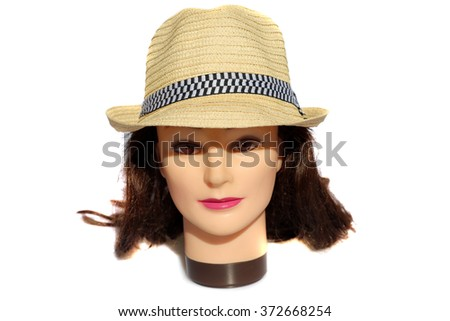 A female Hair Dressers Mannequin Head wears a Tan Fedora Hat.  Isolated on white with room for your text. - stock photo