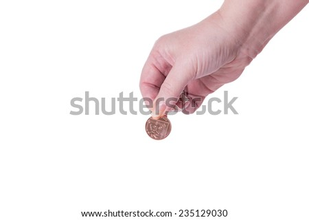 A Female Hand Holding a Coin Isolated on a White Background.