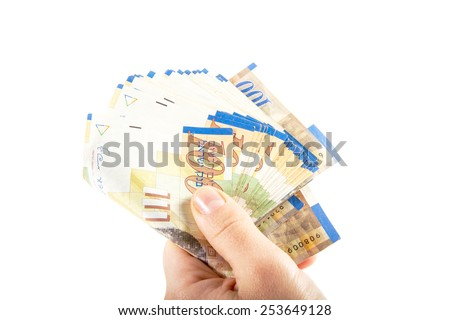 A female hand holding One hundred shekel bank notes against white background. Concept photo of money, banking ,currency and foreign exchange rates. - stock photo