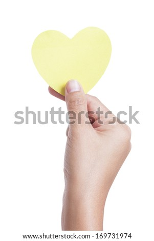 A female hand holding paper heart, isolated on white background. with using path - stock photo