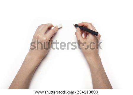 A female hands hold(pick up) black pencil and eraser isolated white, top view at the studio. - stock photo