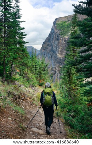 A female hiker in Banff national park view with mountains and forest in Canada. - stock photo