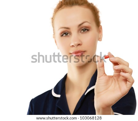 A female nurse giving pills - stock photo