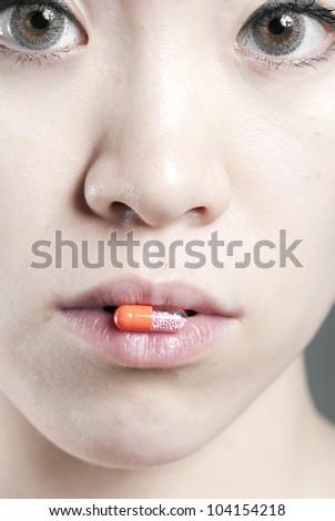 A female oral a medicine - stock photo