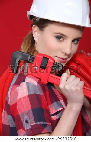 A female plumber. - stock photo