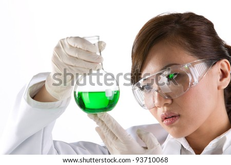 A female scientific researcher looking at a liquid solution.