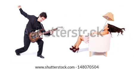 A female singer and a male guitarist in action in white background. The singer is blown away by the powerful sound of the guitar