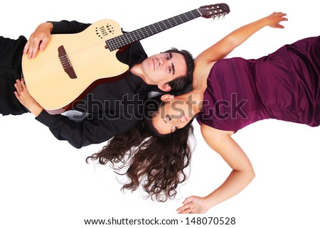 A female singer and a male guitarist laying down in white background - stock photo