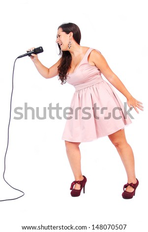 A female singer in action in white background