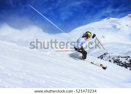 A female ski driver on the piste in Alps by Lech, Austria.