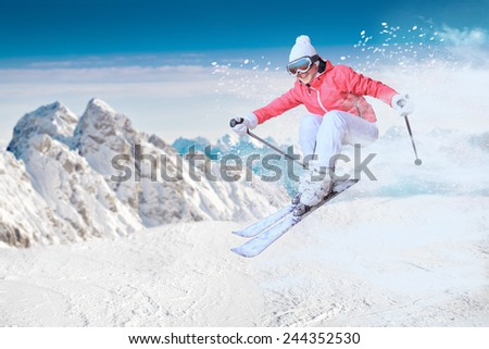 A female skier on the piste in Alps, Europe. - stock photo