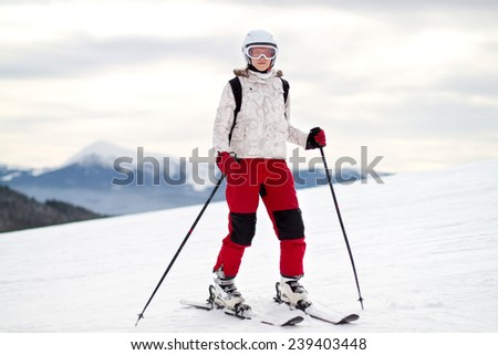 A female skier on the piste in mountain