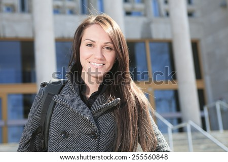 A Female student outside in the winter season